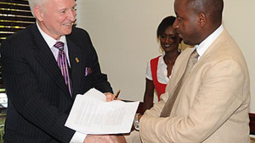 International Property Foundation CEO (L) Norman Flynn and the Chairman Steering Committee of REAR Charles Haba after the signing. (Photo J Mbanda)