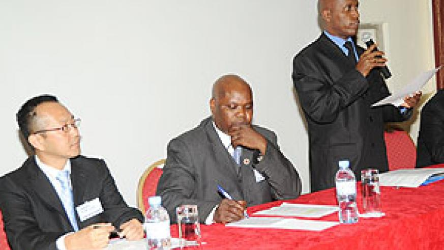 Director General of Education Erasme Rwanamiza (R) opening the Workshop, with JICA's Kazuyoshi Nakai (L) and Allan Lingambe from Zambia. (Photo; J. Mbanda)