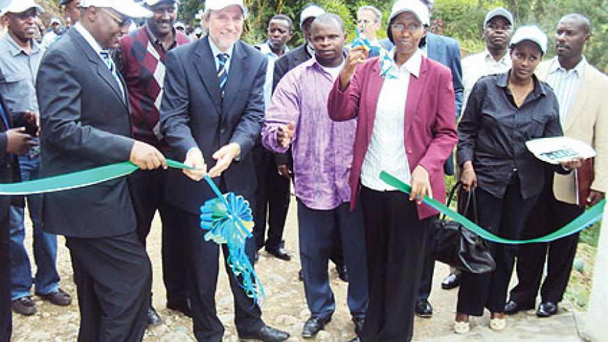 State Minister in charge of Energy and Water Eng. Colette Ruhamya cuts the ribbon commission the plant in the company of Dutch Ambassador.