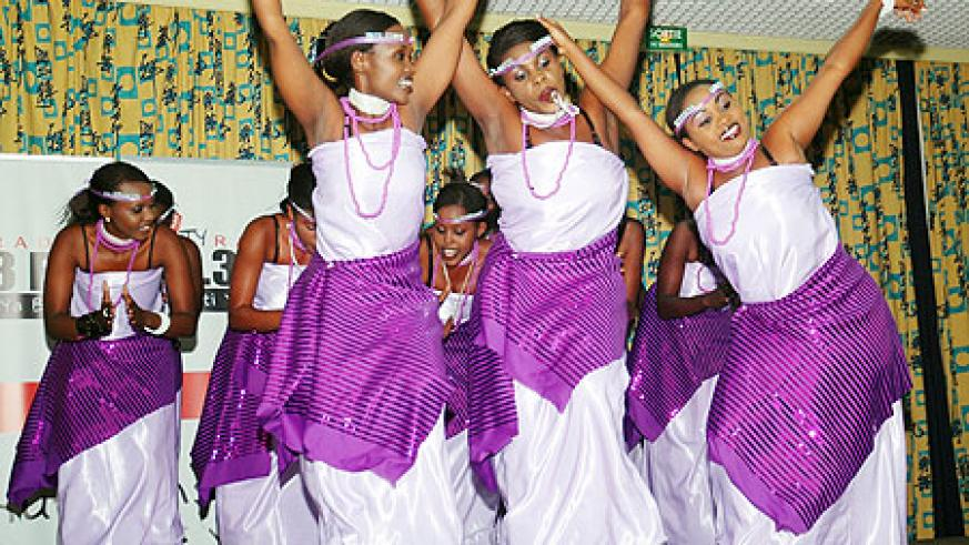 Inganzo Ngali queen dancers show their dance moves as they throw their arms in the air.