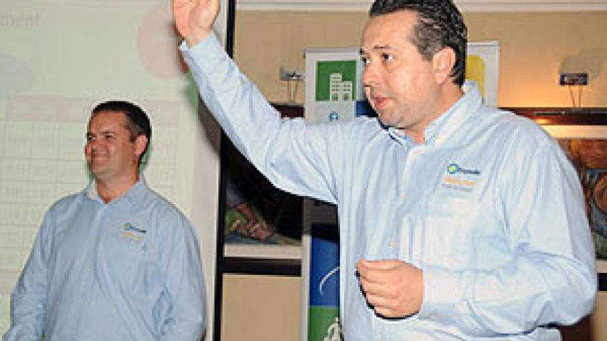 Expedia Inc's Diego Lofeudo (R) and Ross Kata during the launch yesterday in Kigali. (Photo; J Mbanda)