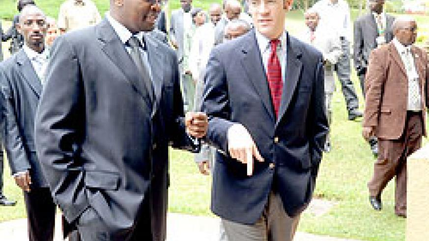 Local Government Minister James Musoni (L) chats with Global Integrity Managing Director Nathaniel Heller on Tuesday. (Photo / J. Mbanda)