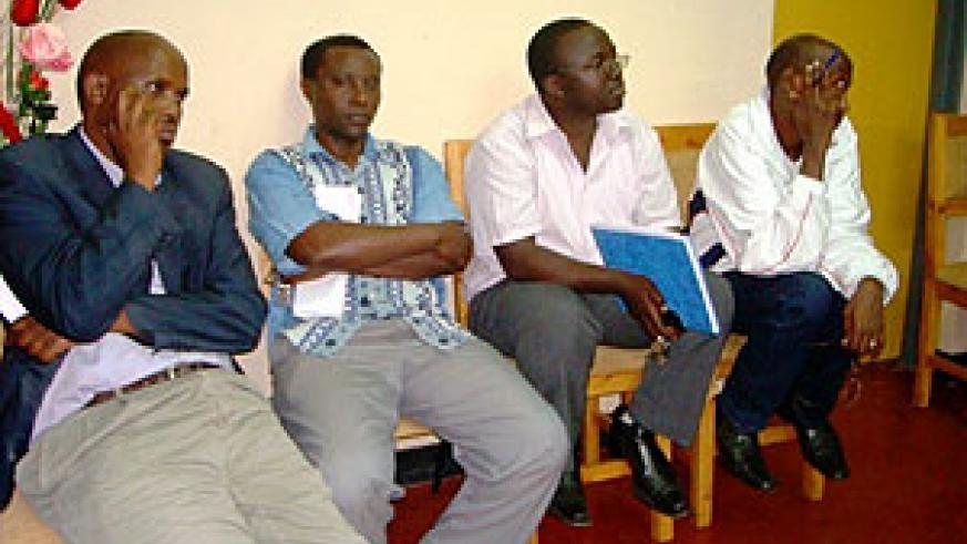 Eric Nikize (Second from right holding book) during a recent district employees meeting. (File photo)