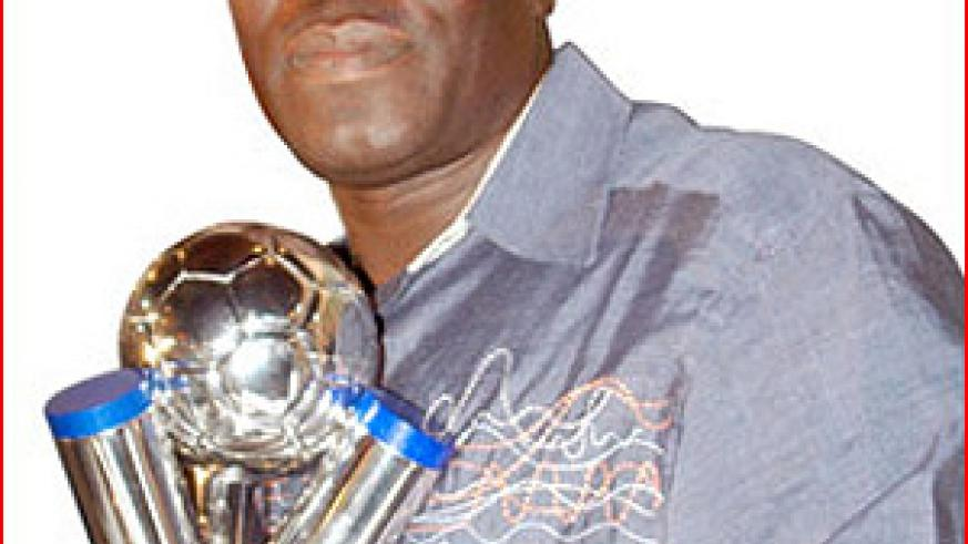 Sellas Tetteh With World Cup Trophy