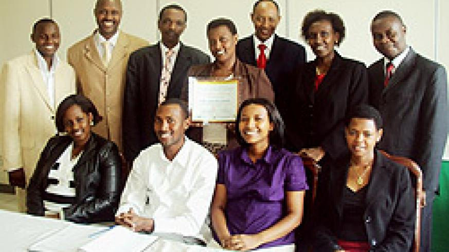 Dr. Balinda Rwigamba (3rd from right) standing, together with the staff and students who participated in the competition  (courtesy photo)