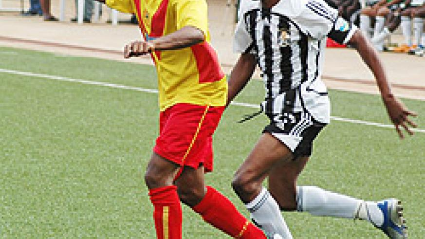 Adane Girma protects the ball from APR skipper Patrick Mafisango during a friendly early this year.  (File Photo)