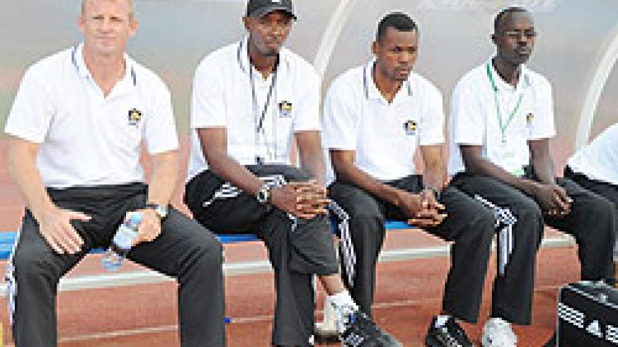 APR head coach Erik Paske (L) flanked by his assistant Eric Nshimiyimana, goalkeeping coach Ramathan Nkunzingoma and team doctor during the Kagame Cup final on Saturday. (Net photo)