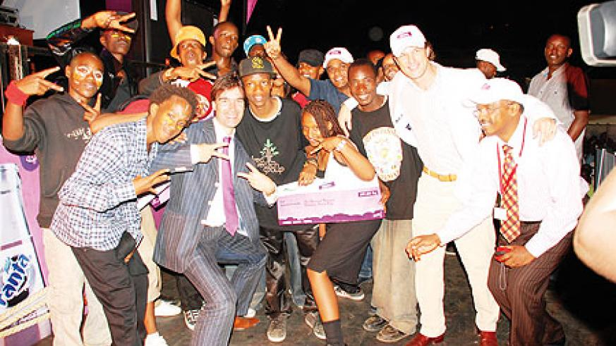 We made it! Satisfied strike a pose with the officials from Bralirwa after the competition.