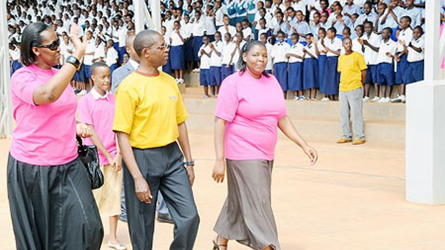 First Lady, Jeannette Kagame waves to School Children as she arrives at Nyamirambo Stadium for the awarding ceremony along with the state Minister for primary and secondary education, and KCC Executive Secretary, yesterday. (Photo J. Mbanda)
