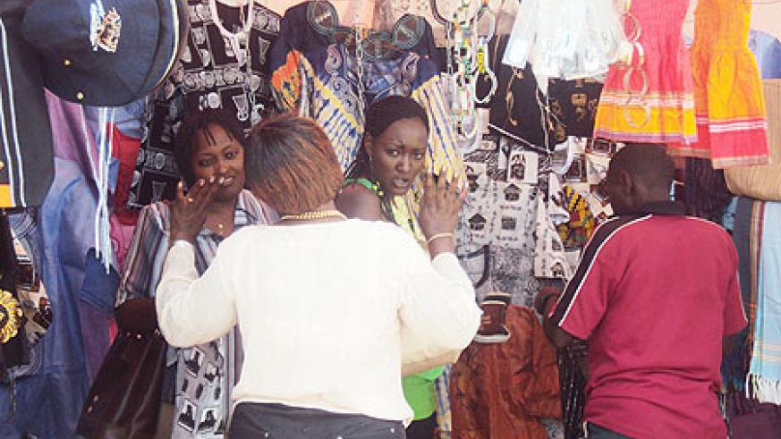 A Kenyan exhibitor gestures to potential buyers at the  expo. (Photo, D. Sabiiti)