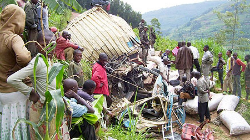 Kigoma residents watching the wreckage of the Fuso truck involved in an accident on Monday. Photo A.Gahene