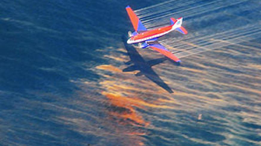 The crew of a Basler BT-67 fixed wing aircraft release oil dispersant over an oil discharge from the mobile offshore drilling unit, Deepwater Horizon, off the shore of Louisiana.