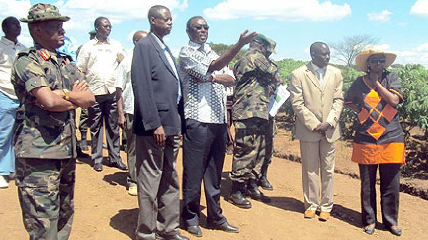 Prime Minister Bernard Makuza with the Minister of Defence Gen.James Kabarebe during the tour of RDF's cassava plantation in Eastern Province. (Photo / S. Rwembeho)