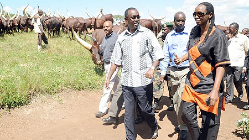 Prime Minister Bernard Makuza with Agriculture Minister Agnes Kalibata during their tour of an RDF Farm in Bugesera District on Monday  (Photo /  J. Mbanda)