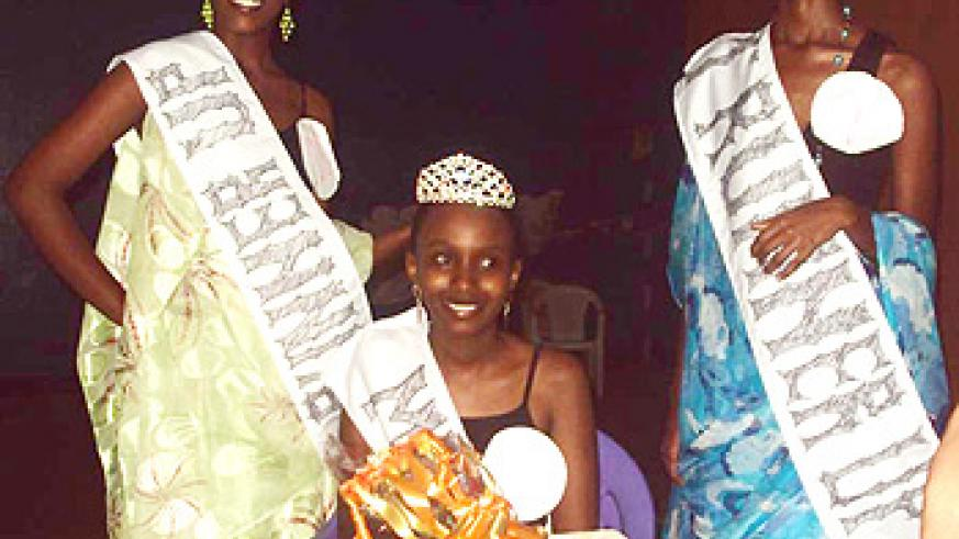 All smiles. Miss Lycee De Kigali 2010 (c) poses for a photo with the 1st (l) and 2nd runner-ups (r)
