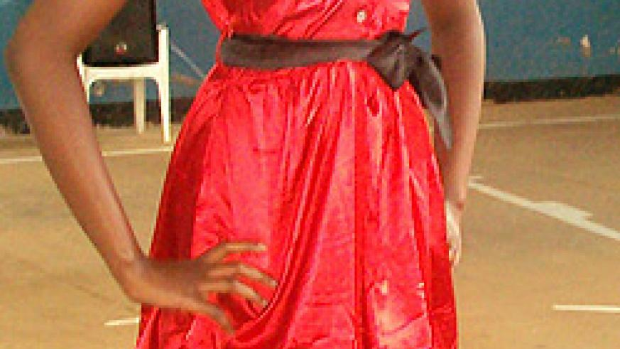 One of the beauty contestants dressed a hot red dinner dress.