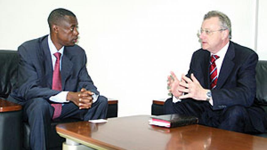 Gen. James Kabarebe (L) during his meeting with Belgium's Special Envoy to the Great Lakes region Ambassador Frank De Coninck yesterday (Courtesy photo)