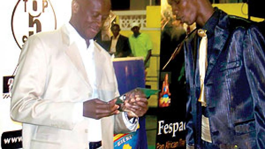 (L) The Minister of Sports and Culture, Joseph Habineza was the guest of honour.