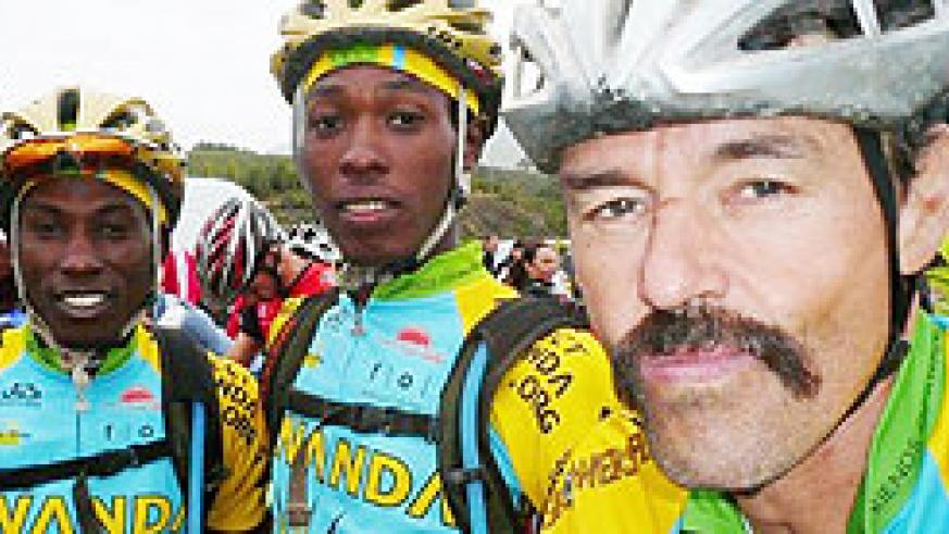 Team Rwanda cyclists pose for a photo with team coach Jonathan Boyer.