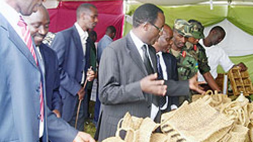 Gov Fidele Ndayisaba (in spectacles) inspects works displayed in a mini-expo held at the sidelines of Taxpayers Day celebration. Photo P Ntambara