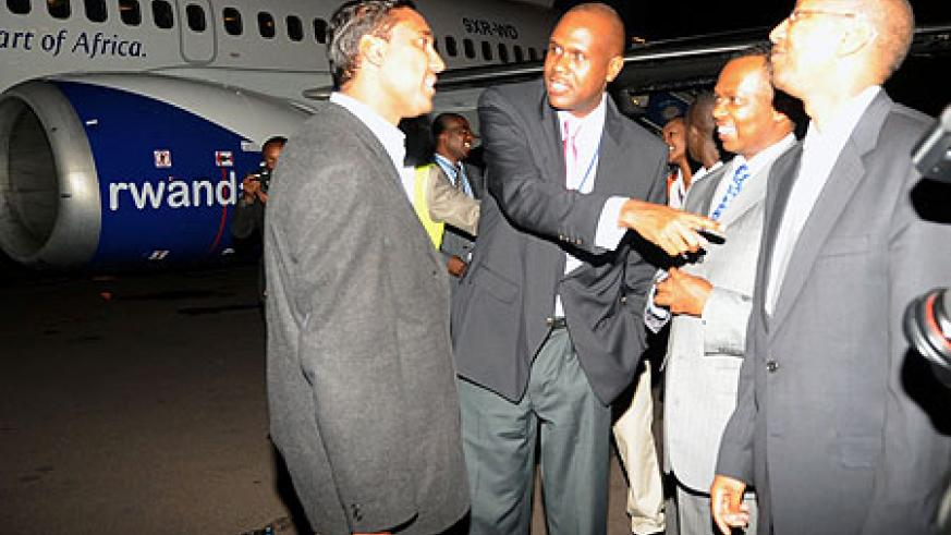 RwandAir's Board Chairman, John Mirenge, introduces the head of the maintenance team to the Ministers of Infrastructure, Vincent Karega, and Finance John Rwangombwa, shortly after the plane arrived yesterday.