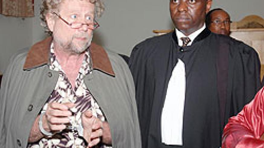 The Embattled American lawyer Peter Erlinder (Glasses) at Intermediate Court of Gasabo (File photo)