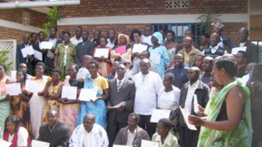 World Vision Twiyubake project trainees display their certificates in a group photo on Monday. (Photo: A. Gahene)