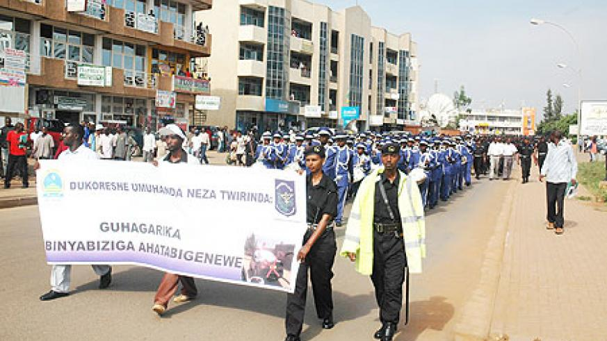 Policemen and women marching during the launch of the National Police's Hygiene, Road and Environmental safety week in Kigali city (Photo; F. Goodman)