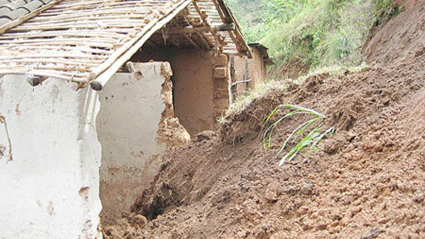 A house which was crushed by the surging land slide killing three people.