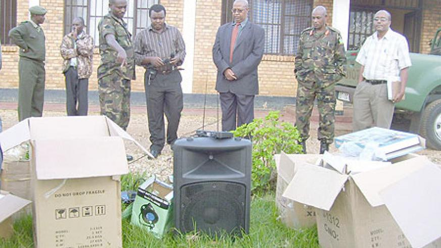 RDF medical services director, Dr. Charles Murego (center) flanked by Brig. Gen Eric Murokore at the hand over ceremony of  the equipment. (Photo: A. Gahene)
