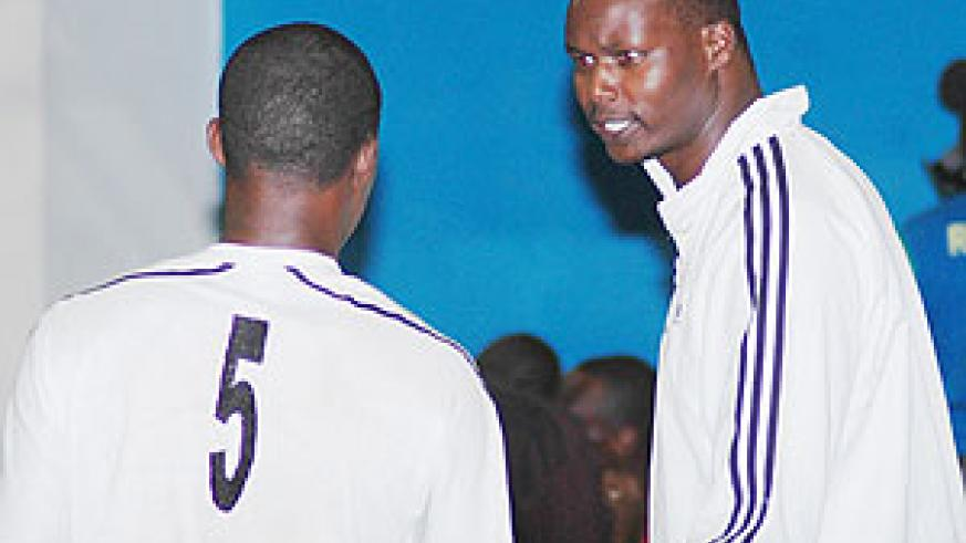 Paul Bitok passes on some tips to an APR player during a past competition.