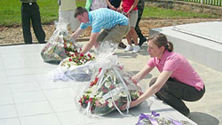 Lt. Col. Diane Ryan (R) laying a wreath on a grave at Murambi Genocide Memorial Centre yesterday