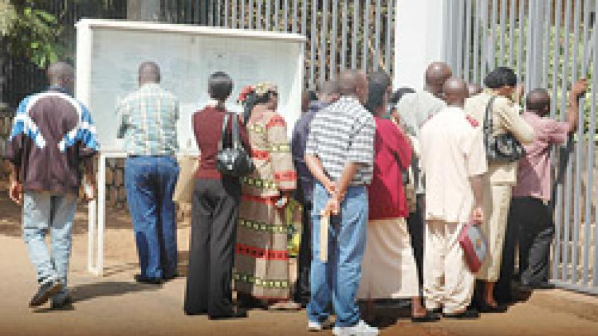 HOPING AND WAITING: Visa applicants queuing up at the Belgian Embassy yesterday morning (Photo; F. Goodman)