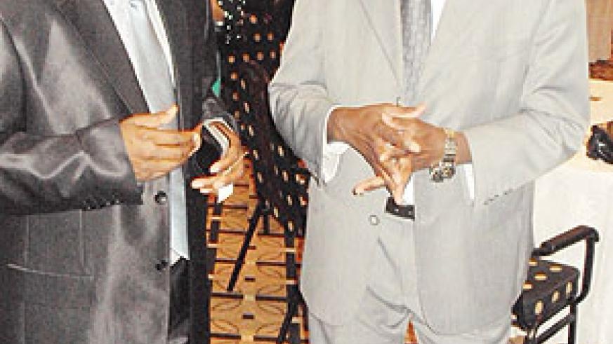 (FROM L-R) Joseph Habineza(MINSPOC) and Emmanuel Bugingo the Managing Director FESPAD during the launch.