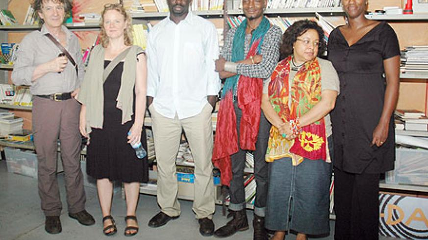 The visiting delegation poses for a photo, far right is Carole Karemera. (Photo: F. Goodman)