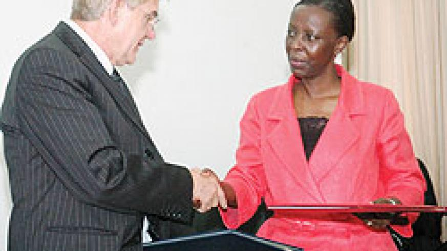 Foreign Affairs, Minister Louise Mushikiwabo, shakes hands with German envoy, Elmar Timpe, after signing the MoU (Photo F Goodman)