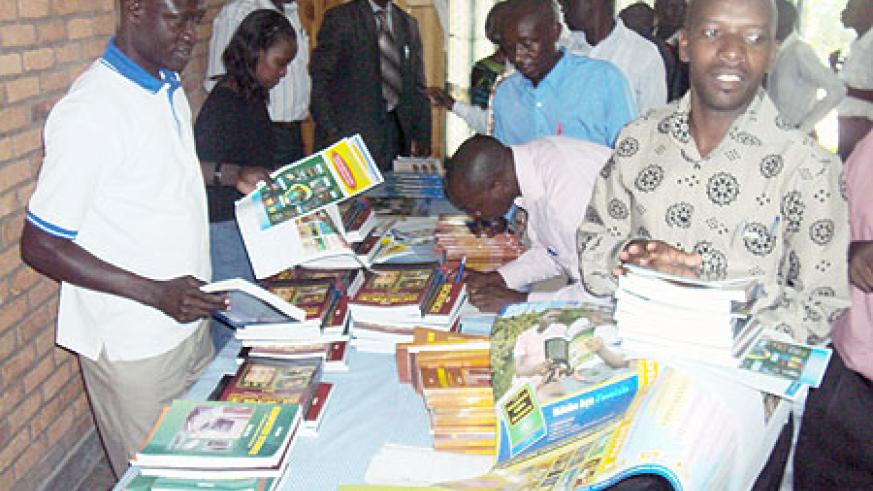 Some of the head teachers receiving the text books in Karongi District on Thursday (Photo S Nkurunziza)