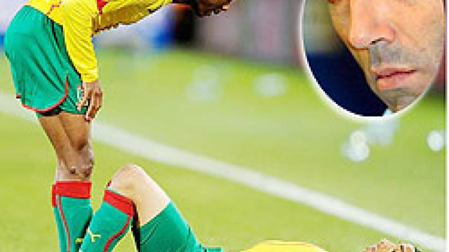 Cameroon captain tries to raise Benoit Assou-Ekotto's spirits after the Indomitable lions slip to an unlikely defeat against Japan. Inset is Paul Le Guen