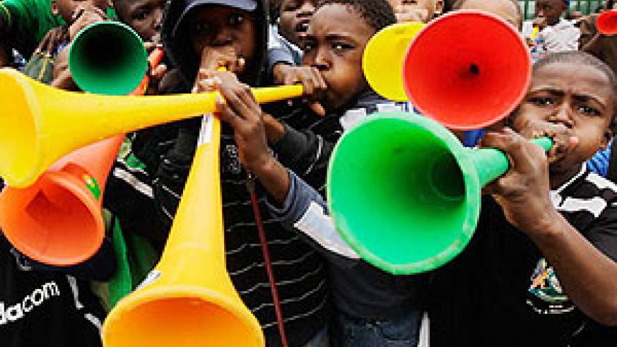 South African boys can't resist the Vuvuzela.