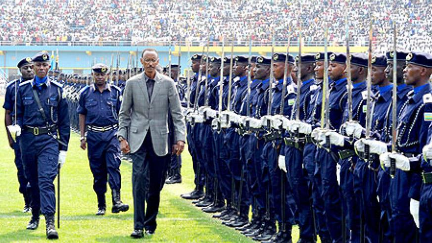 President Kagame inspects a Guard of Honour mounted by the newly promoted Police Cadets yesterday at Amahoro Stadium.