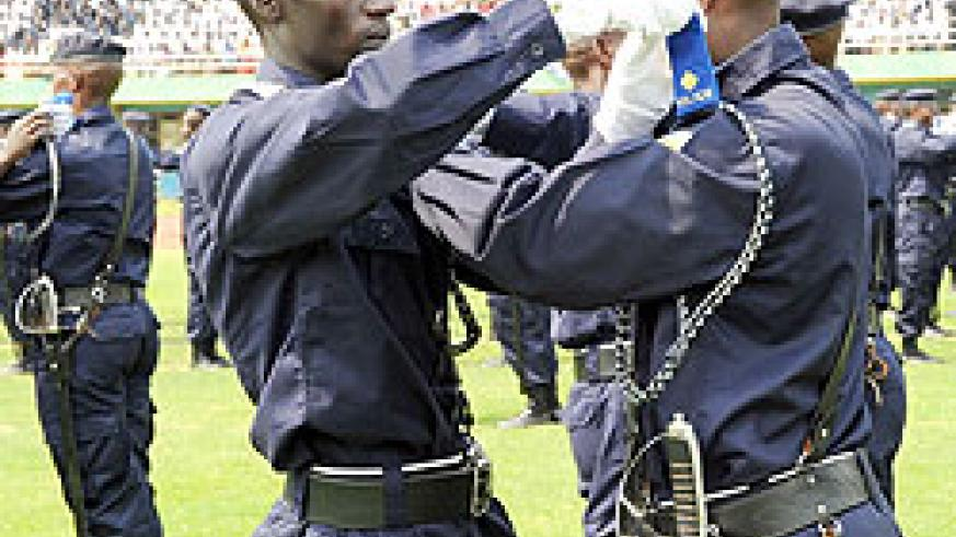 Police cadet officers put on their new pips for the rank of assistant Inspector of Police. (Photo / J. Mbanda).