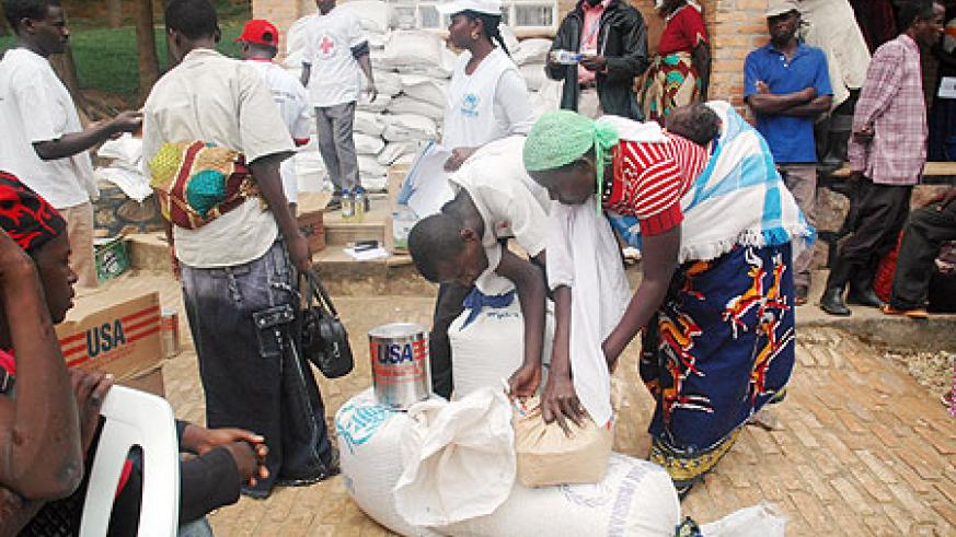 Returnees receive food aid shortly before being dispatched off to their homes last year (File photo).