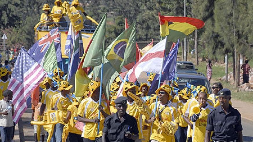 Soccer fans marched to Amahoro carrying flags