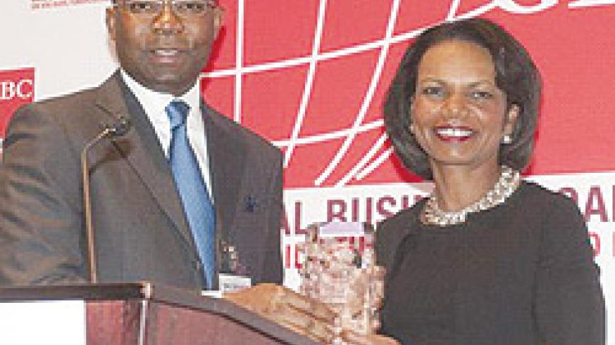 CEO, Access Bank Plc, Aigboje Aig Imoukhuede (left); presenting the Global Business Coalition (GBC) Vision and Impact Award to the 66th US Secretary of State Condoleezza Rice, at the 2010 GBC's conference, in Washington D.C, USA