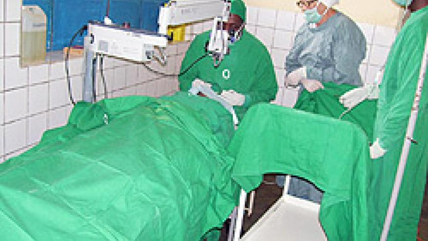 Army medical personnel carry out an eye operation on a patient at Byumba hospital (Photo; A. Gahene)