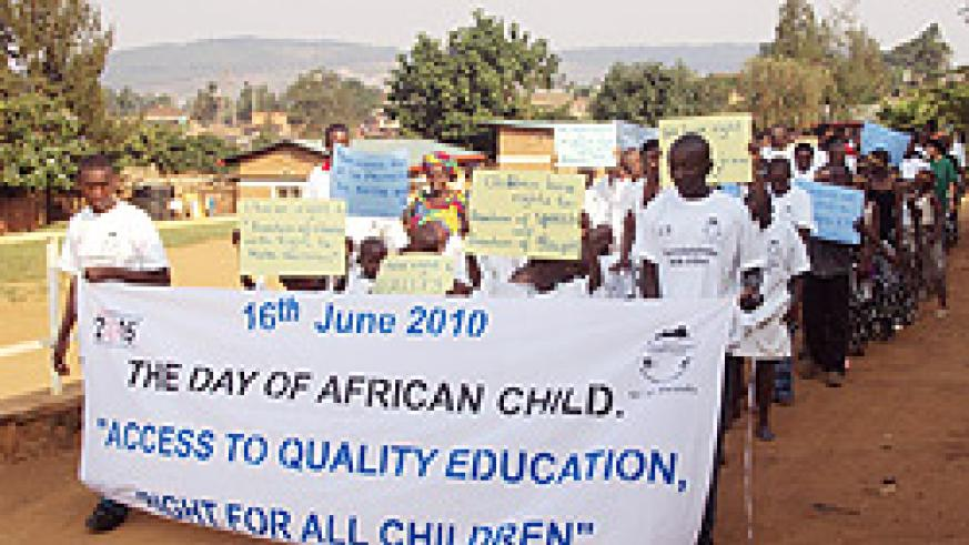Children marching to campaign for their right to access education (Photo; Fred Ndoli)