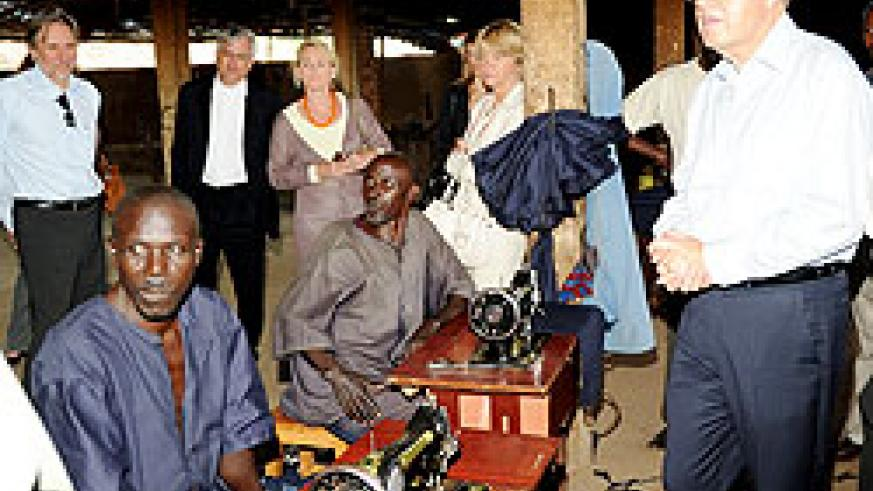 Dutch Minister, Ernst Hirsch Ballin (R), during his visit to a TIG tailoring workshop in Bugesera District yesterday (Photo; J. Mbanda)