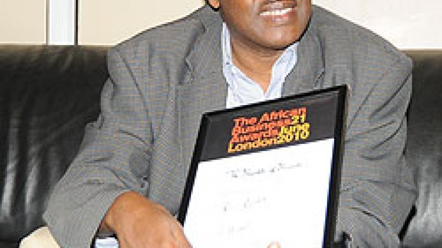 Dr.Charles Murigande with the Award Certificate. (Photo; J Mbanda)