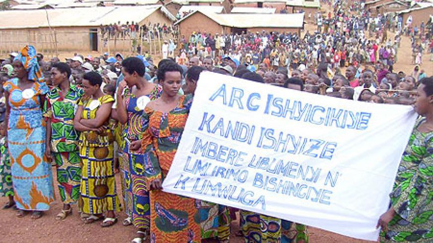 Refugee women trained in tailoring carry a placard hailing ARC initiative to promote vocational training, during celebrations to mark world Refugee Day. (Photo / A. Gahene)