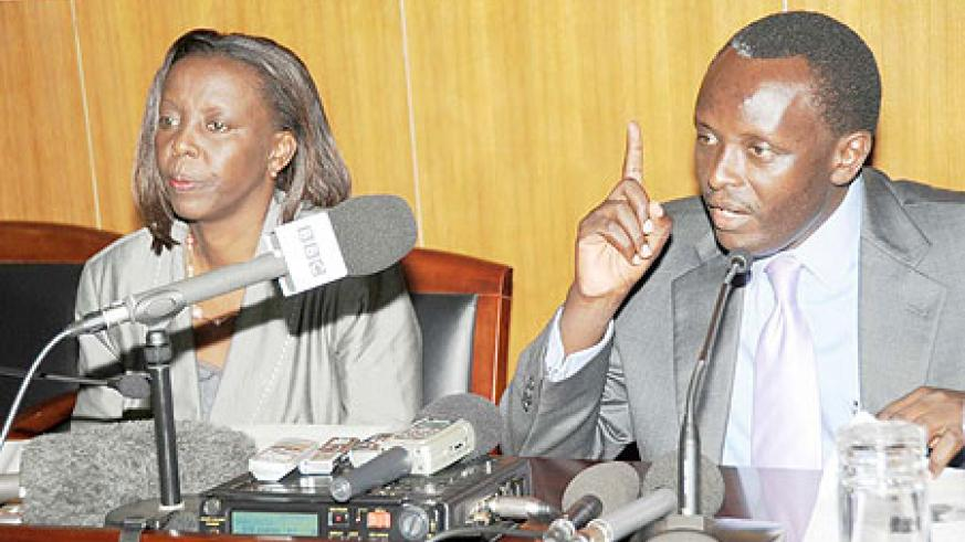Prosecutor General Martin Ngoga (R) stresses a point as Foreign Affairs Minister Louise Mushikiwabo, looks on yesterday (Photo / J. Mbanda)